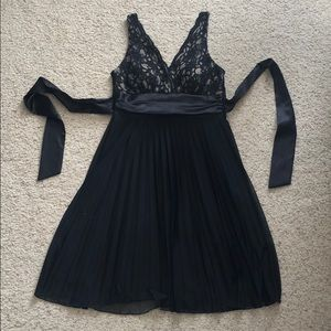Black lace, chiffon, and satin dress by Studio Y.